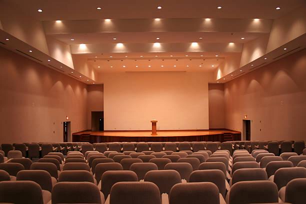 Empty auditorium with grey seats and downlights:スマホ壁紙(壁紙.com)
