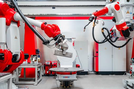 Robotics「Industrial welding equipment in factory」:スマホ壁紙(9)