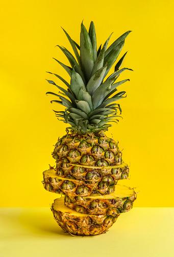 Pineapple「Sliced pineapple against yellow background」:スマホ壁紙(8)