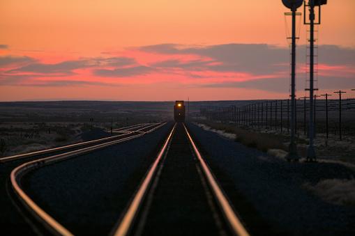 Approaching「Sunset over train on tracks in rural landscape」:スマホ壁紙(4)