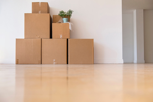 Renting「Cardboard boxes stacked against wall in empty apartment」:スマホ壁紙(18)