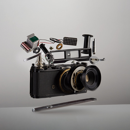 Turkey - Middle East「Parts and components of a disassembled analog vintage film camera floating in the air on white background」:スマホ壁紙(11)