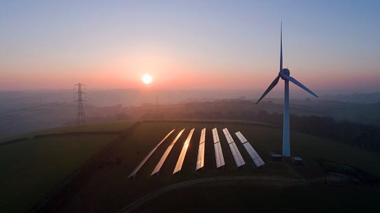 Power Equipment「Solar panels and wind turbines in field」:スマホ壁紙(6)