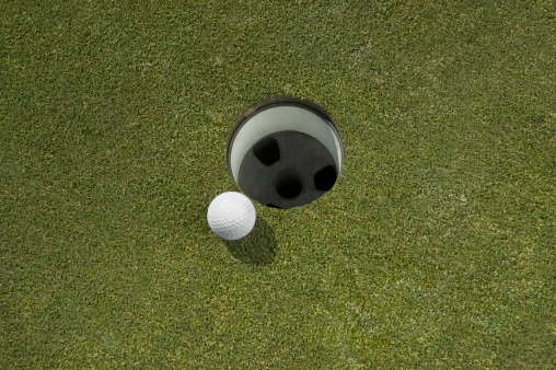 Weekend Activities「Golf ball near hole, close-up」:スマホ壁紙(8)