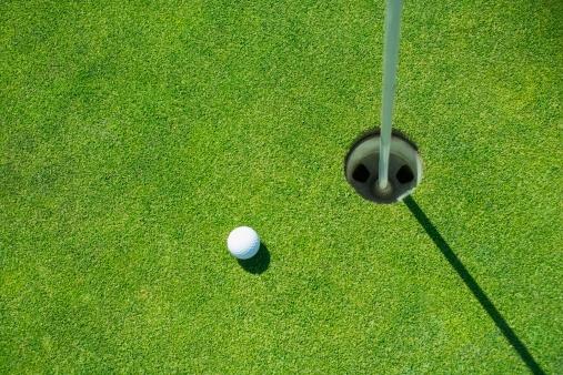 Weekend Activities「Golf ball near cup on putting green outdoors」:スマホ壁紙(13)