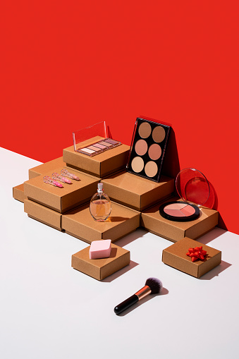 Box - Container「Gift boxes and makeup accessories organized neatly on red and white background」:スマホ壁紙(11)