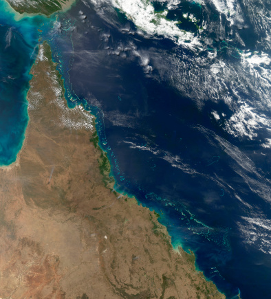 Queensland「August 9, 2011 - Satellite view of the Australian coast between the Great Barrier Reef and the Queensland shore.」:スマホ壁紙(0)