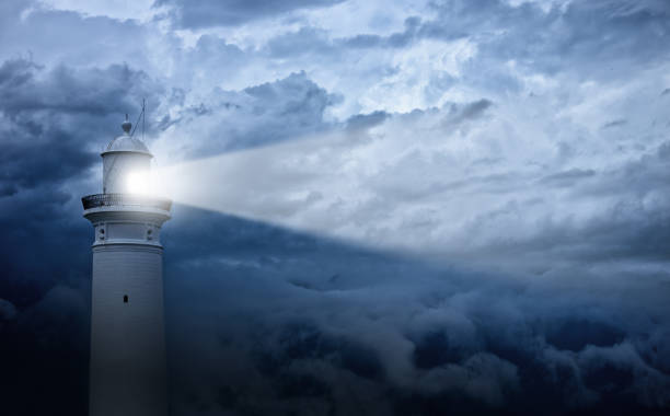 Lighthouse and bad weather in background:スマホ壁紙(壁紙.com)