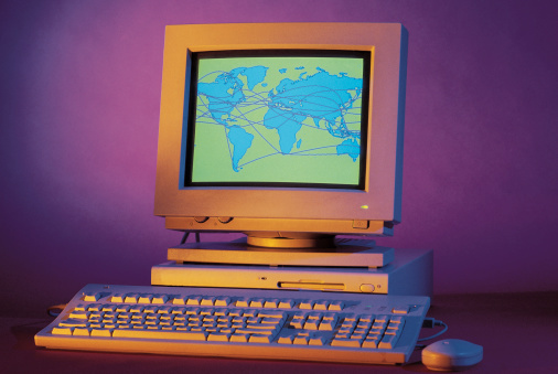 1990-1999「Desktop computer with graphics displaying the world」:スマホ壁紙(5)