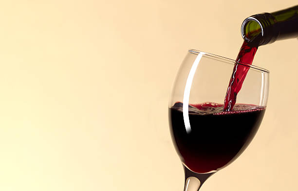 Pouring glass of red wine with copy space:スマホ壁紙(壁紙.com)