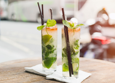 Alcohol - Drink「Two glasses of Mojito on table of sidewalk cafe」:スマホ壁紙(18)