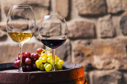 Wineglass「Two glasses of red and white wine in the cellar with grapes」:スマホ壁紙(11)
