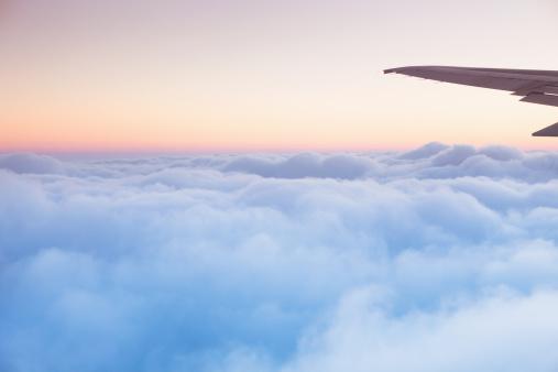 Central America「Soft clouds blanket the sky during flight」:スマホ壁紙(16)