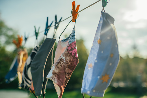 Laundry「Reusable fabric protective face masks hanging outdoors and drying in a sunny day」:スマホ壁紙(13)