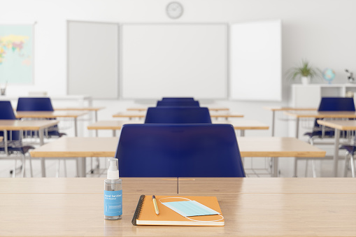 High School Building「Mask, Notebook And Pencil On The Desk With Blurred Empty Classroom」:スマホ壁紙(15)