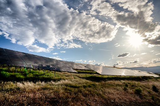 Power Equipment「A Solar Farm In Western Colorado Near Sunset With The Sun, Blue Sky And Clouds Reflecting Down On The Solar Panels」:スマホ壁紙(15)