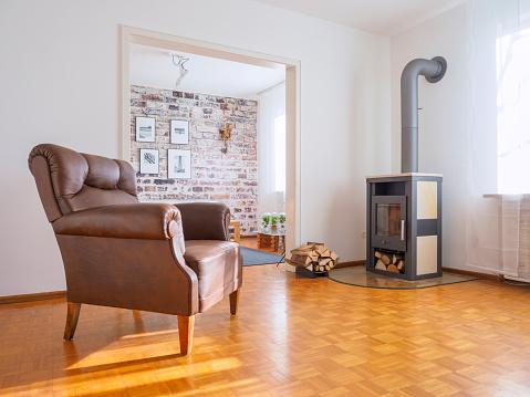 Log「Germany, modern living room, leather chair and fireplace」:スマホ壁紙(17)