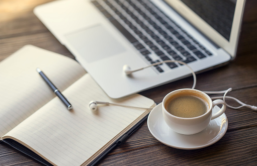 Coffee Cup「Earbuds with notebook and coffee near laptop」:スマホ壁紙(8)