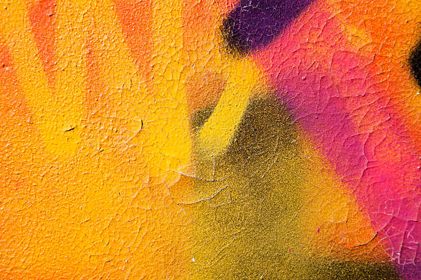 Colorful graffiti over a cracked surface:スマホ壁紙(壁紙.com)