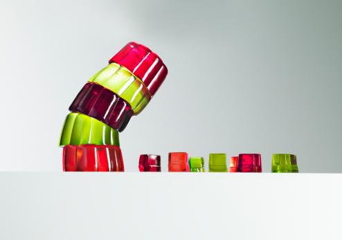 Domination「Stack of vibrant gelatin dessert leaning over small gelatin dessert cubes」:スマホ壁紙(7)