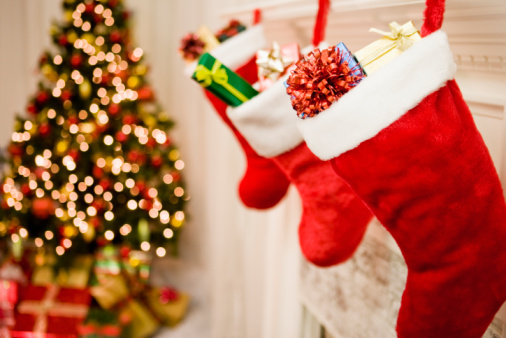 Christmas Decoration「Christmas stockings hanging, Christmas tree in background, close-up」:スマホ壁紙(4)