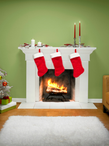 Mantelpiece「Christmas stockings hanging over fireplace」:スマホ壁紙(13)