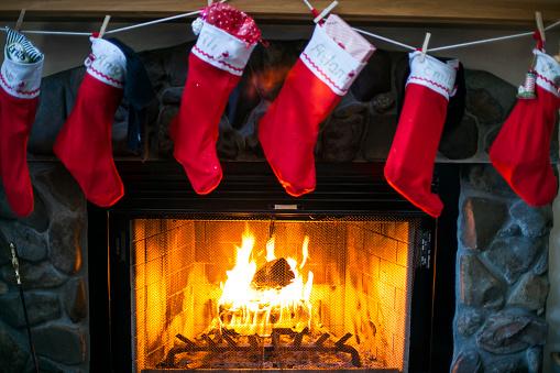 Christmas Stocking「Christmas stockings hanging over fireplace」:スマホ壁紙(13)