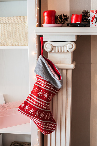 Christmas Decoration「Christmas stocking hanging on fireplace」:スマホ壁紙(9)
