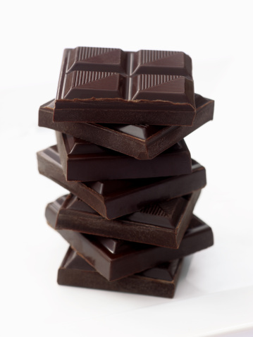 Temptation「Slabs of chocolate piled up to form tower.」:スマホ壁紙(16)