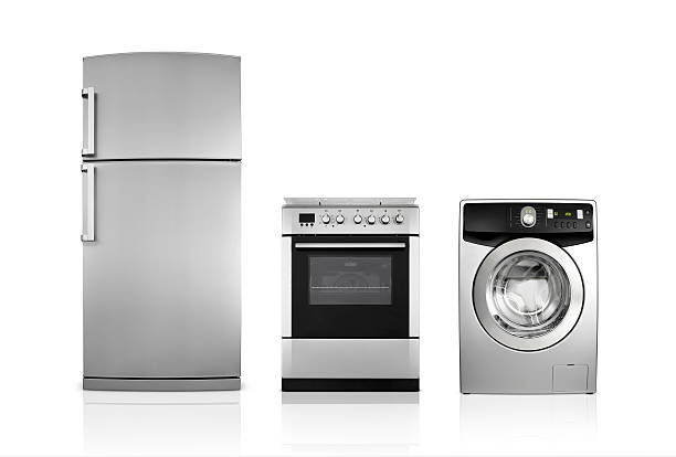 A silver fridge, an oven and dryer lined up side by side:スマホ壁紙(壁紙.com)
