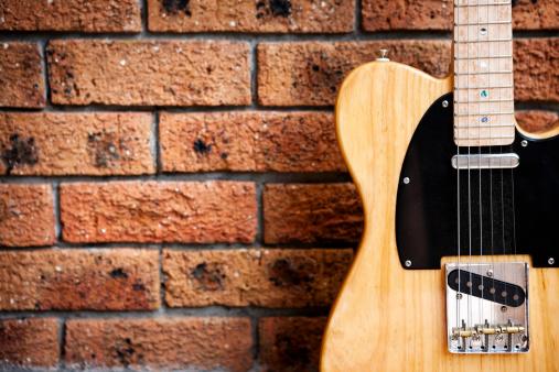 Rock Music「Classic  American electric guitar against textured brick wall」:スマホ壁紙(5)