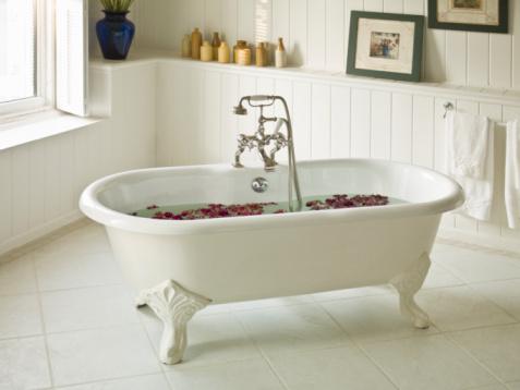 Body Care「a water-filled bathtub with flower petals」:スマホ壁紙(18)