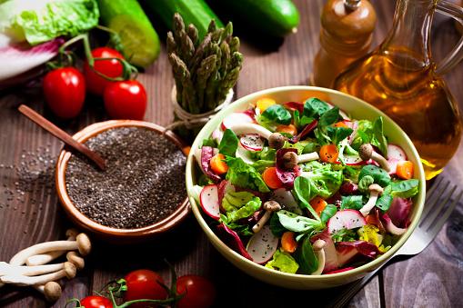 Seed「Preparing healthy salad with chia seeds on rustic wood table」:スマホ壁紙(19)