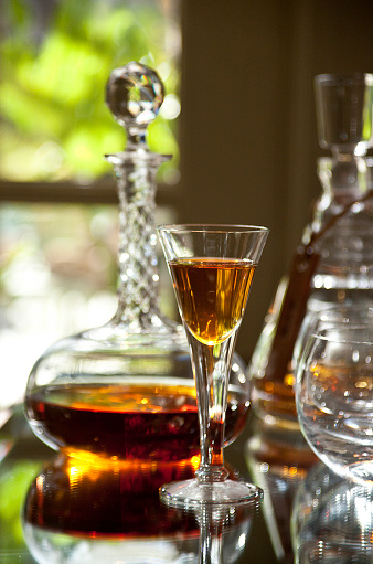 Bar - Drink Establishment「Antique crystal glass of brandy or port wine and a crystal decanter behind it in a elegant home bar or drink establishment—part of a series」:スマホ壁紙(3)