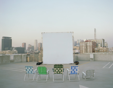 Projection Screen「Folding chairs sitting in front of projection screen on rooftop」:スマホ壁紙(9)