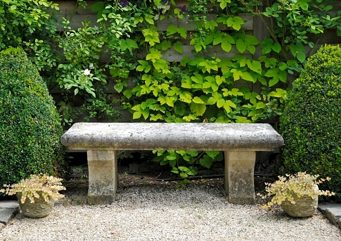 Gravel「Garden with stone bench , buxus plants and potted sedum plants.」:スマホ壁紙(9)