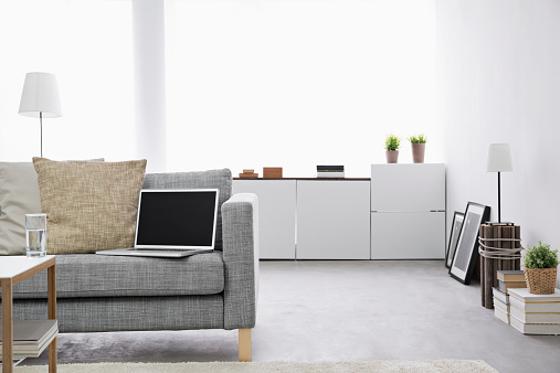 Laptop「Opened laptop on couch at modern living room」:スマホ壁紙(1)