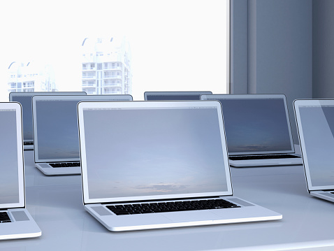 In A Row「Opened laptops on a table in a n office, 3D Rendering」:スマホ壁紙(15)
