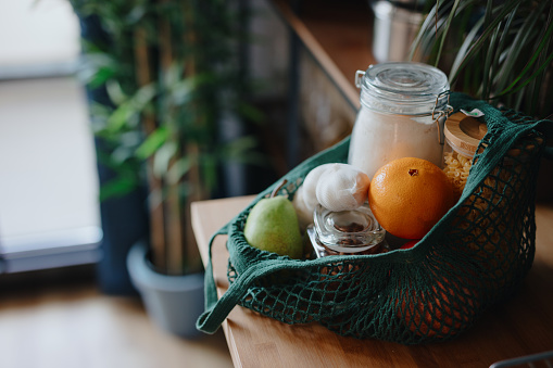 Vegetarian Food「Eco bag on kitchen counter with food in jars and fresh fruits. Zero waste concept」:スマホ壁紙(9)