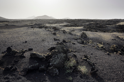 Volcanic Rock「Lava plain and distant volcanoes.」:スマホ壁紙(6)