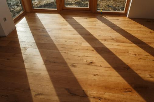 木目「Empty room with finished parquet flooring」:スマホ壁紙(18)