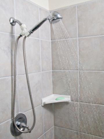 Vertical「a shower head with running water」:スマホ壁紙(16)