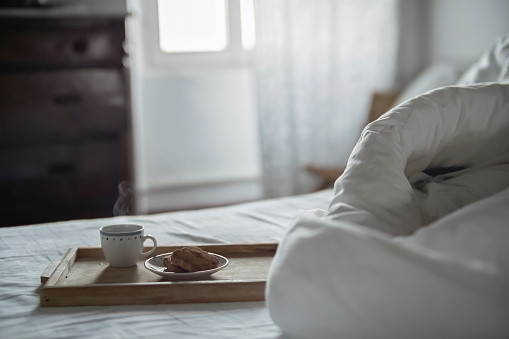 Bedroom「Wooden tray with cup of steaming coffee and biscuits on bed」:スマホ壁紙(18)