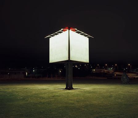 Advertisement「Illuminated billboard sign by side of highway at night」:スマホ壁紙(19)