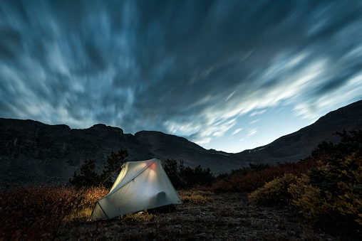 Tent「Illuminated camping tent under cloudy sky」:スマホ壁紙(0)