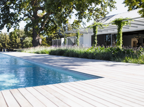 Patio「Poolside by swimming pool of modern home」:スマホ壁紙(8)