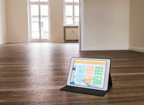 Internet of Things「Tablet with smart home apps on wooden floor」:スマホ壁紙(17)