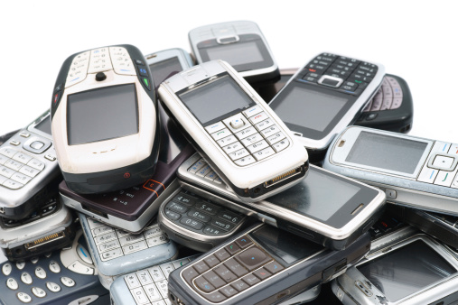 Mobile Phone「Old used cellphones pile close-up isolated on white」:スマホ壁紙(13)