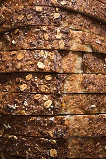 Bread「Close-up of sliced whole grain oat bread」:スマホ壁紙(15)