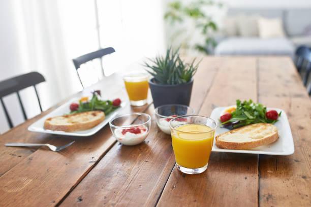 Close-up of fresh breakfast served on wooden table:スマホ壁紙(壁紙.com)